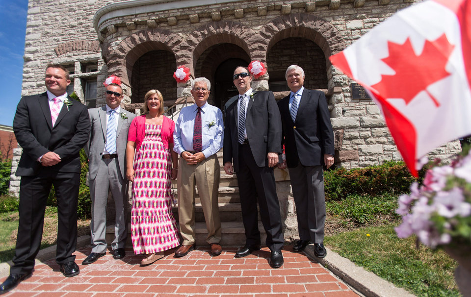 Photo - Canadian Baseball Hall of Fame inductees for 2014, from left, the family of scout Jim Ridley, sons Jeremy, Shayne and daughter Shannon, former Montreal Expos General Manager Murray Cook , Expos 3rd baseman Tim Wallach and Expos broadcaster Dave Van Horn, pose for a photo in front of City Hall in St. Mary's, Ontario, Saturday, June 21, 2014. (AP Photo/The Canadian Press, Geoff Robins)