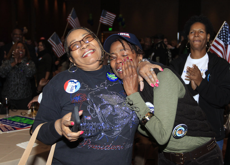 Anita Flanigan, left, and Renee Drake react after President Obama reaches the 270 Electoral College votes during the Michigan Democratic election night party at the MGM Grand Detroit, following Election Day, early Wednesday, Nov. 7, 2012. (AP Photo/Carlos Osorio)