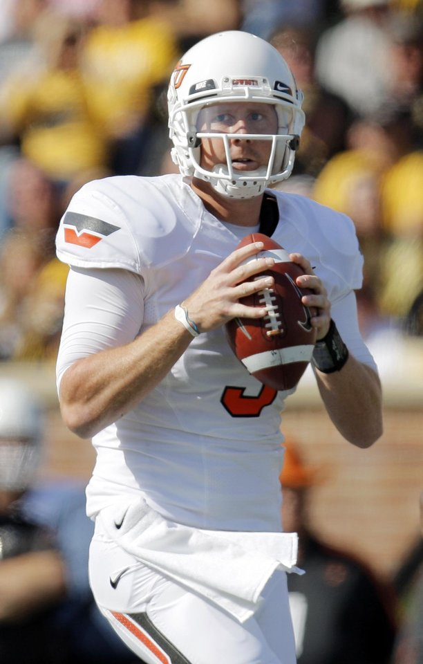 Photo - Oklahoma State's Brandon Weeden (3) looks to pass during a college football game between the Oklahoma State University Cowboys (OSU) and the University of Missouri Tigers (Mizzou) at Faurot Field in Columbia, Mo., Saturday, Oct. 22, 2011. Photo by Nate Billings, The Oklahoman ORG XMIT: KOD