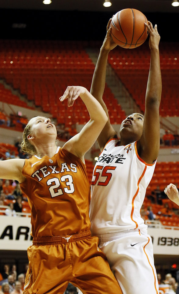 Photo - Oklahoma State's LaShawn Jones (55) grabs a rebound over Gigi Mazionyte (23) during a women's college basketball game between Oklahoma State University (OSU) and the University of Texas at Gallagher-Iba Arena in Stillwater, Okla., Saturday, March 2, 2013. Photo by Nate Billings, The Oklahoman