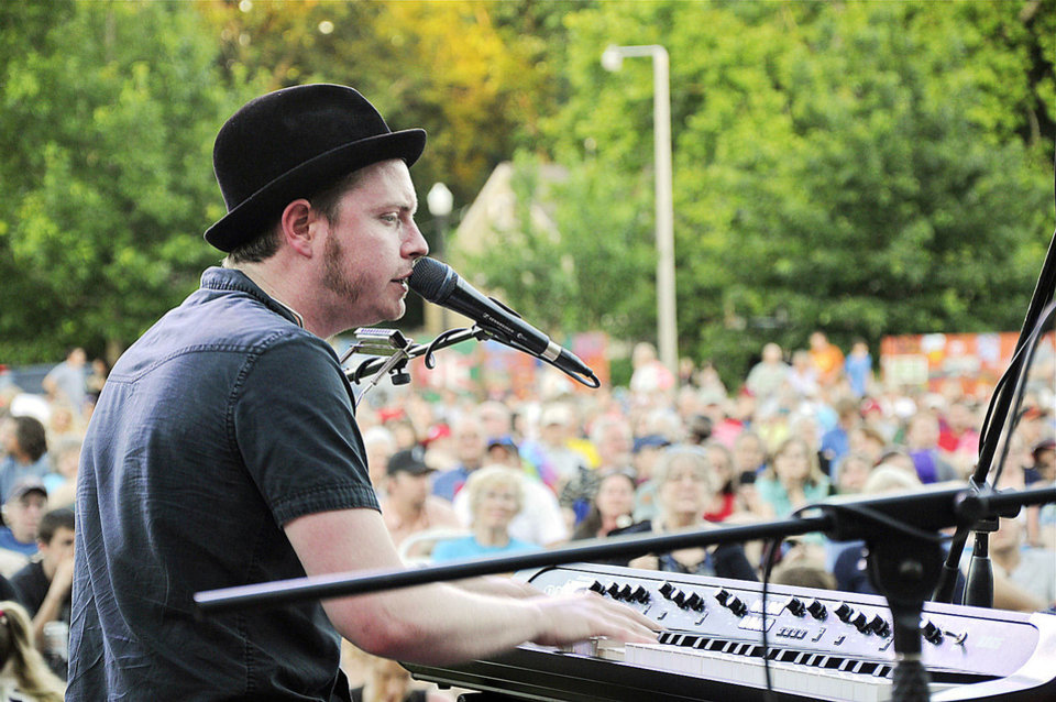 Photo - Grammy nominated singer-songwriter John Fullbright, of Okemah, plays to a crowd of 4,000 in Norman's Lions Park as part of the Summer Breeze Concert Series. Photo by M. Tim Blake, for The Oklahoman  M. Tim Blake