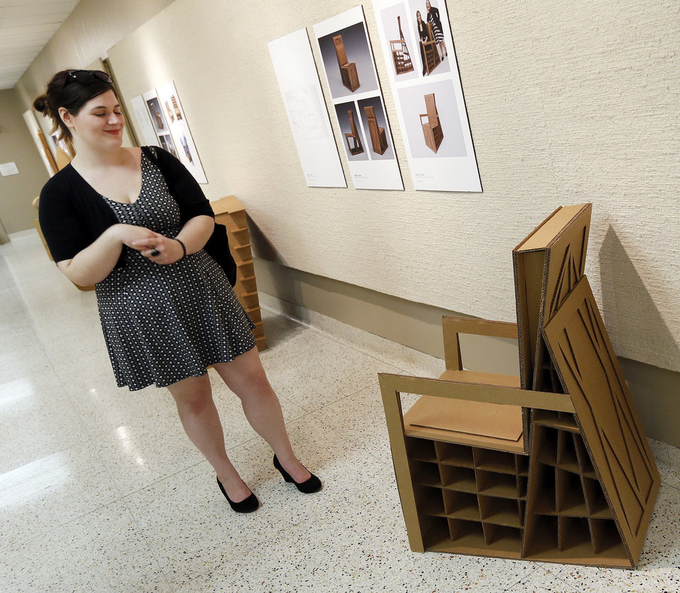 Design student Hayla Perrone looks at one of the chairs during a reception for an exhibition of cardboard chairs at UCO�s Nigh University Center.  Photos by Nate Billings, The Oklahoman