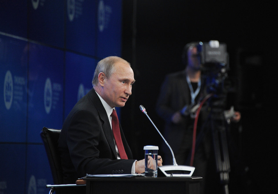 """Photo - Russian President Vladimir Putin speaks during a plenary session of the St. Petersburg International Investment Forum Friday, May 23, 2014. Speaking at the investment forum, Putin blamed the West for encouraging a """"coup"""" in Ukraine, when the nation's pro-Russian president was chased from power after months of protests. He said that Ukraine is now facing """"chaos and a full-scale civil war.""""  (AP Photo/RIA Novosti Kremlin, Mikhail Klimentyev, Presidential Press Service)"""
