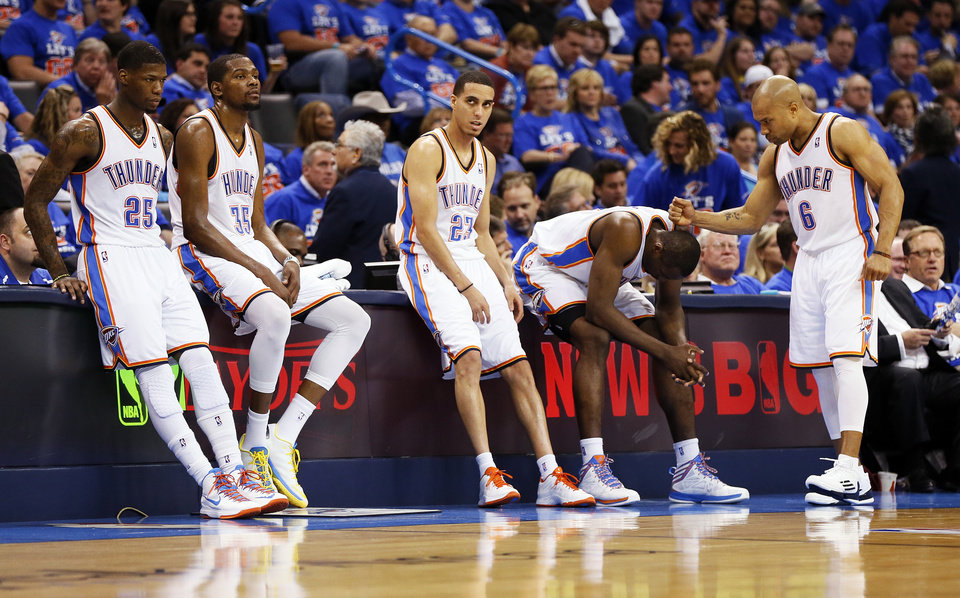 From left, Oklahoma City\'s DeAndre Liggins (25), Kevin Durant (35), Kevin Martin (23), Serge Ibaka (9) and Derek Fisher (6) wait at the scorer\'s table during a break in the action in the second half of Game 5 in the first round of the NBA playoffs between the Oklahoma City Thunder and the Houston Rockets at Chesapeake Energy Arena in Oklahoma City, Wednesday, May 1, 2013. Houston won, 107-100. Photo by Nate Billings, The Oklahoman