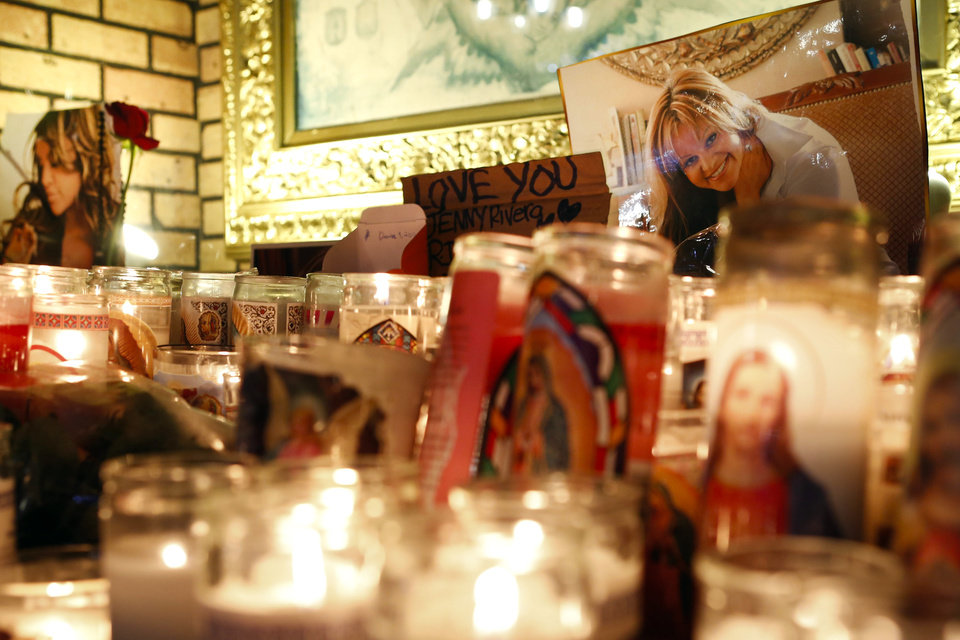 Photo - Candles and pictures are displayed to pay tribute to singer Jenni Rivera at the Plaza Mexico shopping center in Lynwood, Calif., early Monday, Dec. 10, 2012. Authorities have not confirmed her death, but Rivera's relatives in the U.S. say they have few doubts that she was on the Learjet 25 that disintegrated on impact Sunday in rugged territory in Nuevo Leon state in northern Mexico. (AP Photo/Patrick T. Fallon)