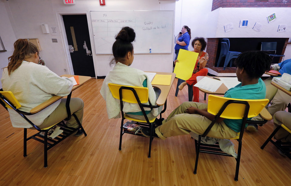 Photo -  Girls in state custody attend classes at the Oklahoma Juvenile Center for Girls in Norman. Karen Cross teaches in the cafeteria. [Photo by Steve Sisney, The Oklahoman]