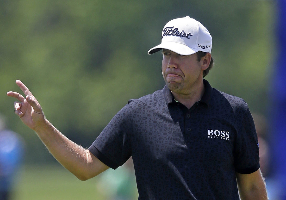 Photo - Erik Compton reacts after a birdie on the ninth hole during the opening round of the Zurich Classic golf tournament at TPC Louisiana in Avondale, La., Thursday, April 24, 2014. (AP Photo/Gerald Herbert)
