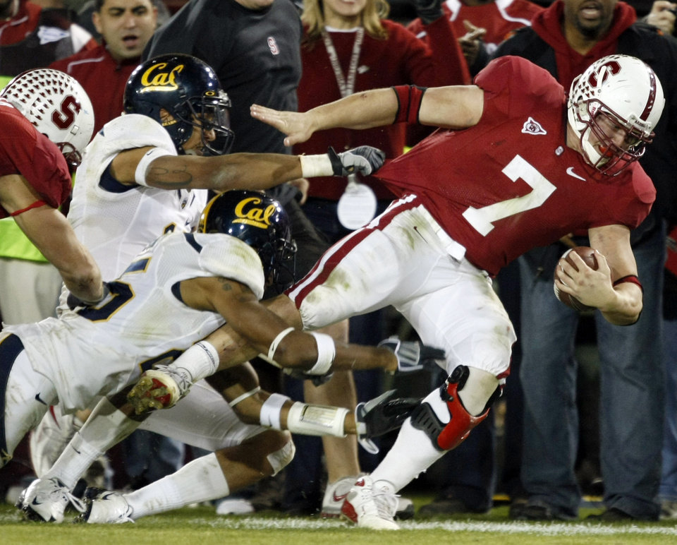Photo - FILE - In this Nov. 21, 2009, file photo, Stanford University running back Toby Gerhart is brought down by a group of California defenders during the fourth quarter of an NCAA college football game in Stanford, Calif. Gerhart may finally have quieted all those skeptics who questioned whether he was too big and powerful to play tailback by becoming a finalist for the Heisman Trophy. (AP Photo/Marcio Jose Sanchez, file) ORG XMIT: NY165