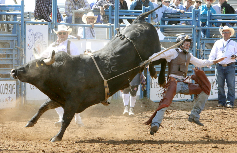 Photo - Bailey Byrum, from Wynnewood, OK, gets thrown from his bull in the Bull Riding event during Tuesday's performances at the International Youth Finals Rodeo at the Shawnee Heart of Oklahoma Exposition Center in Shawnee, OK, Tuesday, July 8, 2014,  Photo by Paul Hellstern, The Oklahoman