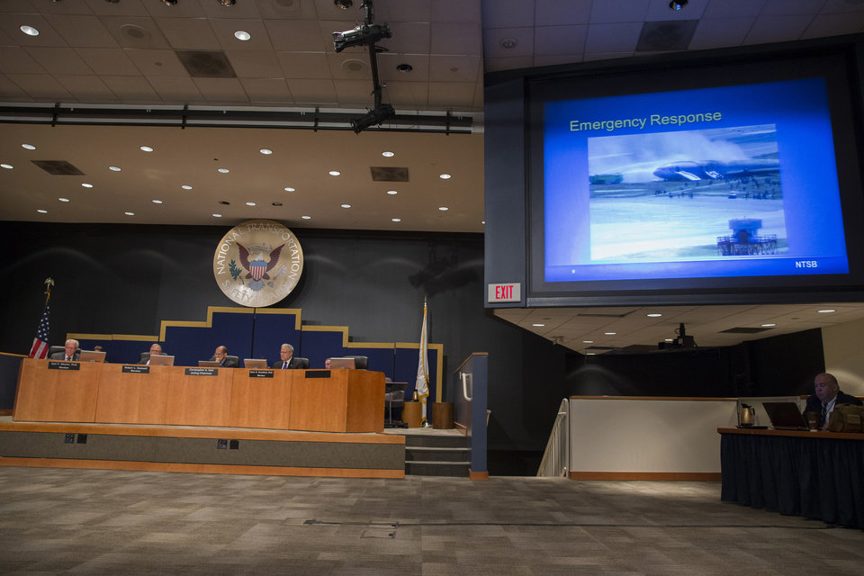 Photo - The National Transportation Safety Board (NTSB) holds a hearing in Washington, Tuesday, June 24, 2014, to establish the cause of Asiana Flight 214 airlines crash in San Francisco, and to make safety recommendations. (AP Photo/ Evan Vucci)