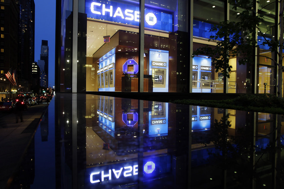 Photo -   Automobiles pass a JP Morgan Chase building Thursday, May 10, 2012, in New York. JPMorgan Chase, the largest bank in the United States, said Thursday that it lost $2 billion in the past six weeks in a trading portfolio designed to hedge against risks the company takes with its own money. The company's stock plunged almost 7 percent in after-hours trading after the loss was announced. Other bank stocks, including Citigroup and Bank of America, suffered heavy losses as well. (AP Photo/Frank Franklin II)
