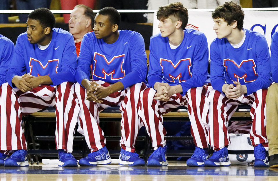 Photo - The Tulsa Memorial Chargers wear striped warm-up pants during the Class 5A boys championship high school basketball game against Bishop McGuinness in the state tournament at the Mabee Center in Tulsa, Okla., Saturday, March 9, 2013. Photo by Nate Billings, The Oklahoman