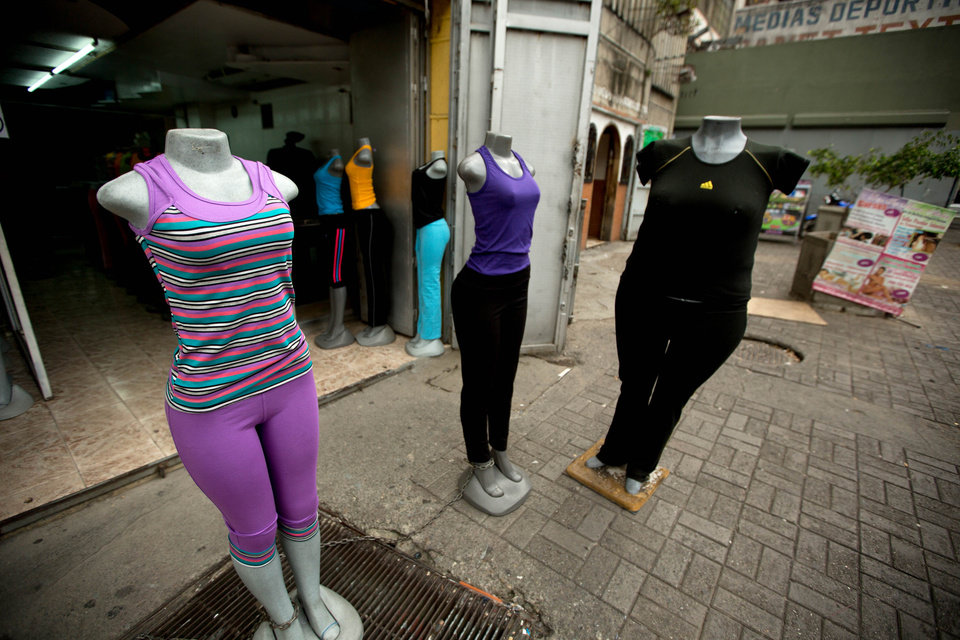 Photo - Mannequins stand at a store that sells clothing for over weight people in downtown Caracas, Venezuela, Tuesday, Aug. 26, 2014. The Venezuelan government has launched a public relations campaign to halt a steady rise in obesity that, if left unchecked, threatens to lead to a costly, public health crisis. (AP Photo/Fernando Llano)