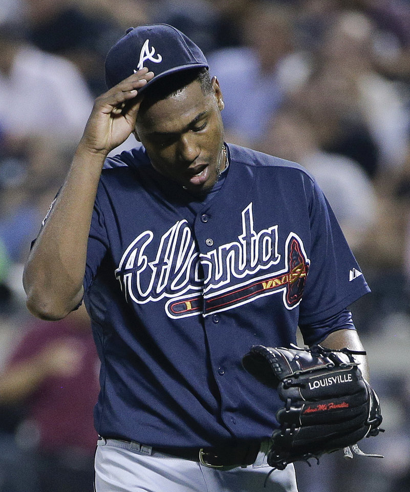 Photo - Atlanta Braves pitcher Julio Teheran walks off the field after being relieved in the fourth inning of a baseball game against the New York Mets, Tuesday, July 8, 2014, in New York. The Mets won 8-3. (AP Photo/Julie Jacobson)