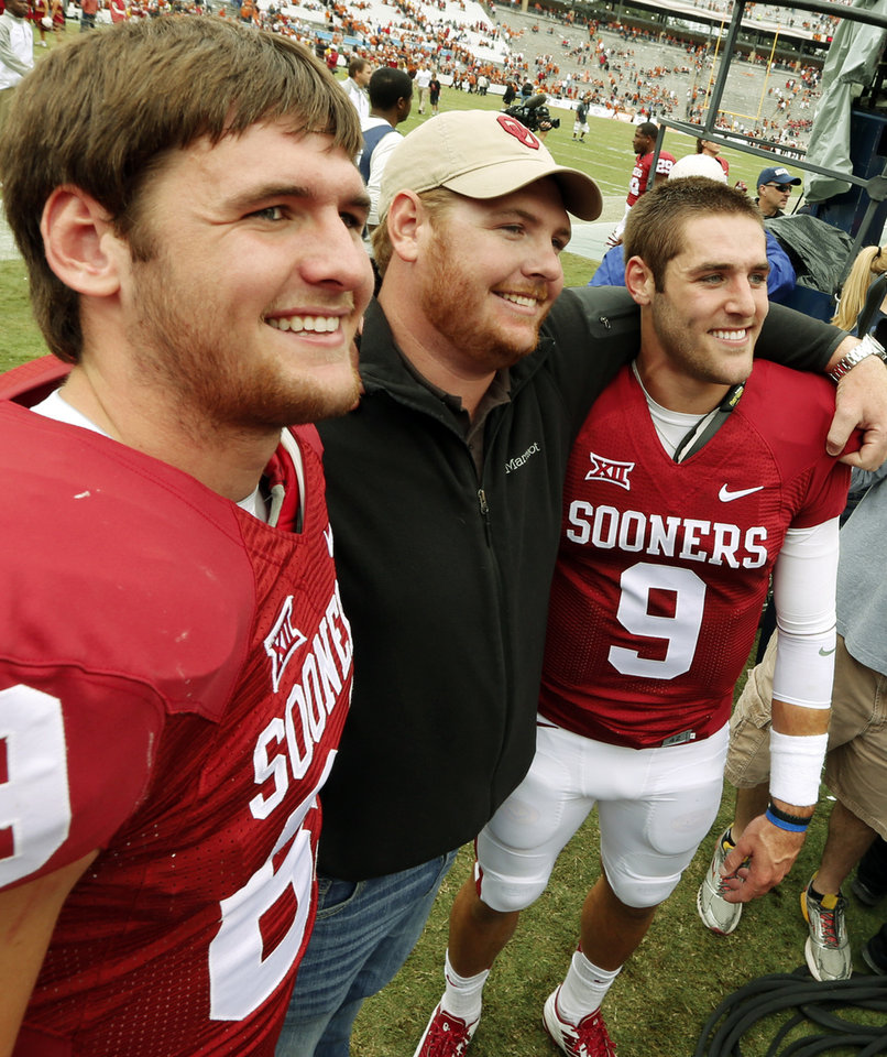 Photo - The Knight brothers, Connor, Tyler and Trevor, celebrate after the Red River Showdown college football game where the University of Oklahoma Sooners (OU) defeated the University of Texas Longhorns (UT)  31-26 at the Cotton Bowl in Dallas, Texas on Saturday, Oct. 11, 2014. 