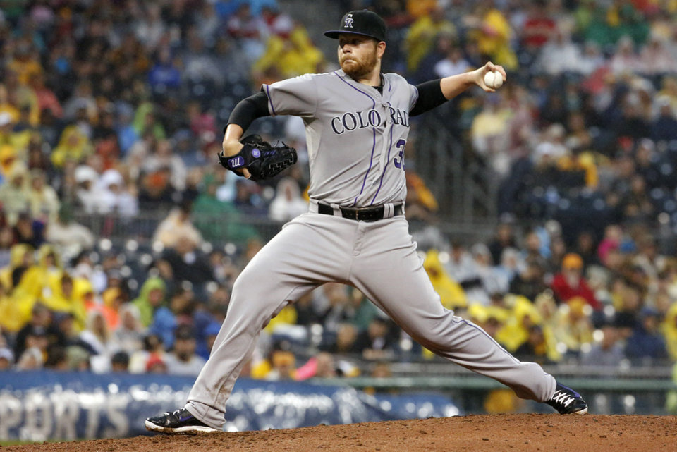 Photo - Colorado Rockies starting pitcher Brett Anderson (30) delivers during the third inning of a baseball game against the Pittsburgh Pirates in Pittsburgh Saturday, July 19, 2014. (AP Photo/Gene J. Puskar)