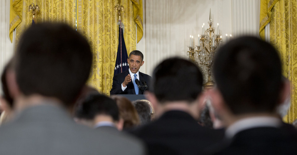 Photo - President Barack Obama gestures as he answers reporters questions during the final news conference of his first term in the East Room of the White House in Washington, Monday, Jan. 14, 2013. (AP Photo/Carolyn Kaster)