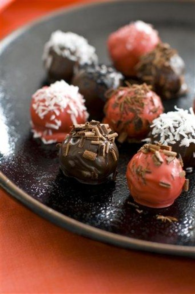 Photo - This Jan. 17, 2012 photo shows quince-filled chocolate marzipan bonbons in Concord, N.H. For a gourmet touch, these bonbons can be sprinkled with some flake sea salt, candy sprinkles, finely crushed nuts or coconut.      (AP Photo/Matthew Mead)