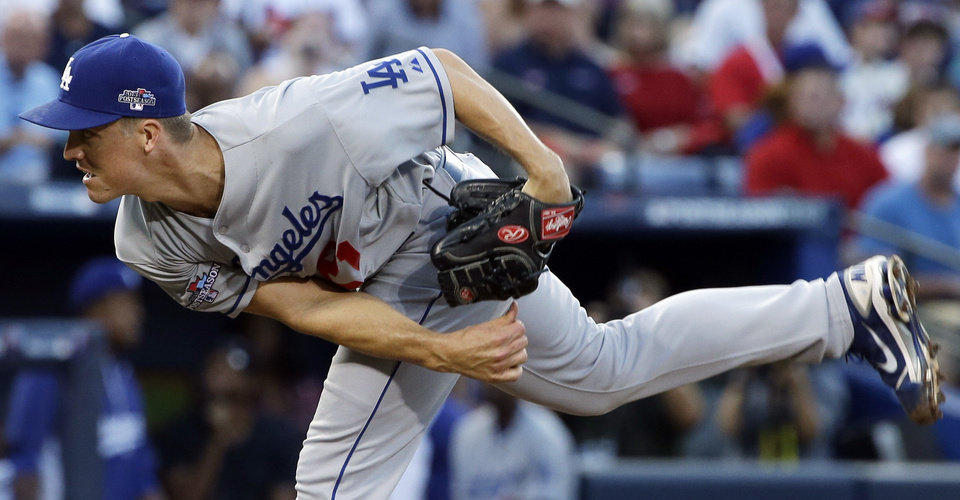 Photo - Los Angeles Dodgers starting pitcher Zack Greinke works against the Atlanta Braves in the first inning of Game 2 of the National League division series on Friday, Oct. 4, 2013, in Atlanta. (AP Photo/John Bazemore)