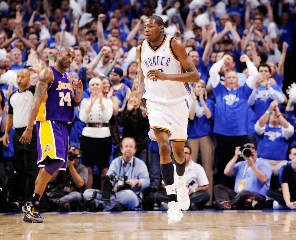 Photo - Oklahoma City fans celebrate after a basket by Kevin Durant (35) as L.A.'s Kobe Bryant (24) walks to the bench for a timeout in the fourth quarter during the NBA basketball game between the Los Angeles Lakers and the Oklahoma City Thunder in the first round of the NBA playoffs at the Ford Center in Oklahoma City, Thursday, April 22, 2010. Oklahoma City won, 101-96. Photo by Nate Billings, The Oklahoman