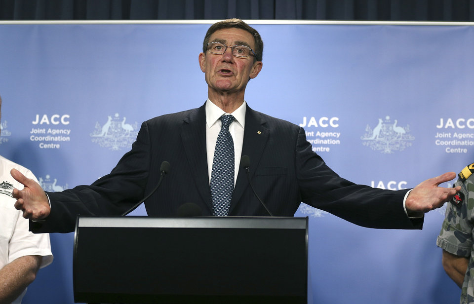 Photo - The chief coordinator of the Joint Agency Coordination Center retired Chief Air Marshal Angus Houston gestures as he speaks at a press conference about the ongoing search operations for missing Malaysia Airlines Flight 370 in Perth,  Australia, Monday, April 14, 2014. Houston said search crews will send a robotic submarine deep into the Indian Ocean on Monday for the first time to try to determine whether underwater signals detected by sound-locating equipment are from the missing Malaysian plane's black boxes.  (AP Photo/Rob Griffith)