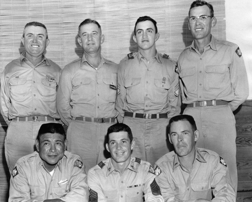 Photo - RIFLE TEAM the 45th infantry division is sending to Camp Perry, Ohio, August 24 for the national rifle association matches is made up of six Thunderbirds, but eight will make the trip-one alternate and a coach.  Back row from left to right: Lt. Col. Paul Hayes, Durant, team coach; Maj. Herbert O'Neal, Oklahoma City; SFC Floyd Hayes, Durant (son of the team captain); and CWO Barnest T. McKean, McAlester.  Second row: Lieut. Tom Bear, Edmond, team alternate; M/Sgt. Bob Nauman, Lawton; and CWO Lloyd Nelson, Tulsa.  OTher member of the team, Capt. Eugene Dollar, Hugo, was not available for the picture.  Staff photo by unknown.  Photo undated and published on 08/18/1957 in The Daily Oklahoman.