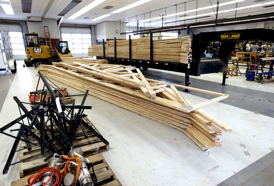 Photo -  Trusses are built from donated lumber at Central Oklahoma Habitat for Humanity. [PHOTO BY STEVE SISNEY, THE OKLAHOMAN]