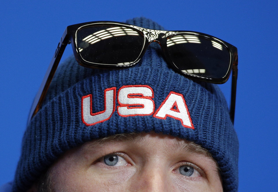 Photo - FILE - In this Thursday, Feb. 6, 2014 file photo United States' Bode Miller looks up during a US ski team press conference at the Gorki media centre at the Sochi 2014 Winter Olympics, in Krasnaya Polyana, Russia. Bode Miller has revealed that he needs Lasik eye surgery and regrets not having the operation before the Olympics. After dominating the training sessions, Miller finished only eighth in Sunday's downhill race. (AP Photo/Christophe Ena, File)