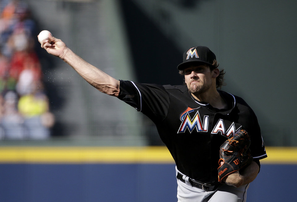 Photo - Miami Marlins starting pitcher Nathan Eovaldi throws in the first inning of a baseball game against the Atlanta Braves, Sunday, Aug. 31, 2014, in Atlanta. (AP Photo/David Goldman)