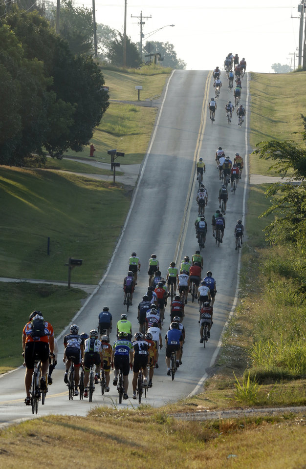 Photo -  Riders tackle a hill during last year's Norman Conquest bicycle ride that benefits the J.D. McCarty Center. PHOTO BY STEVE SISNEY, THE OKLAHOMAN ARCHIVES   STEVE SISNEY -