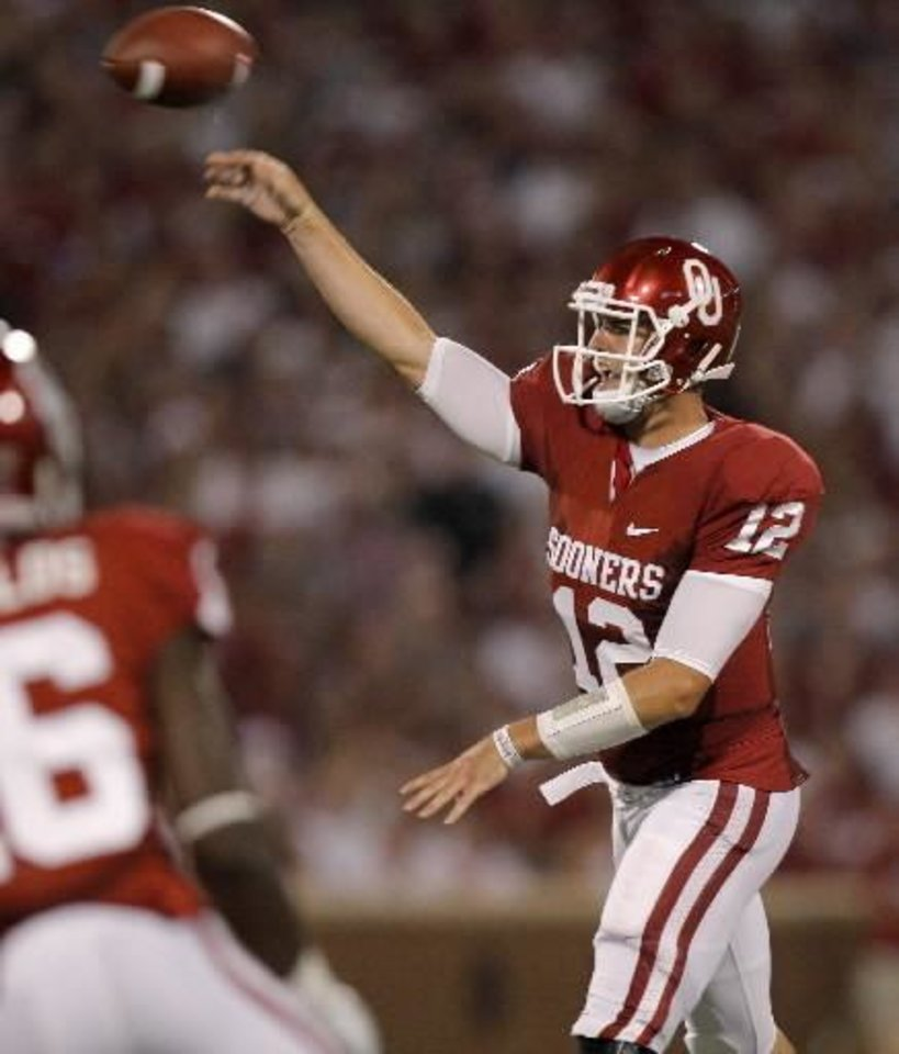 Oklahoma\'s Landry Jones (12) throws a pass during the college football game between the University of Oklahoma Sooners ( OU) and the Tulsa University Hurricanes (TU) at the Gaylord Family-Memorial Stadium on Saturday, Sept. 3, 2011, in Norman, Okla. Photo by Bryan Terry, The Oklahoman ORG XMIT: KOD