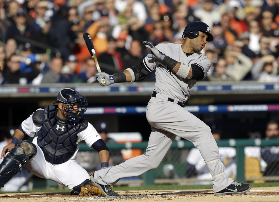 Photo -   New York Yankees' Robinson Cano strikes out swing in the first inning as Detroit Tigers catcher Gerald Laird reaches for the ball during Game 4 of the American League championship series Thursday, Oct. 18, 2012, in Detroit. (AP Photo/Paul Sancya )