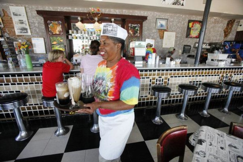 Photo - Ola Hall carries a tray of floats and sundaes at the Grateful Bean Oklahoma City, Oklahoma July 15 , 2010. The Grateful Bean is closing after 18 years of business. Photo by Steve Gooch, The Oklahoman ORG XMIT: KOD