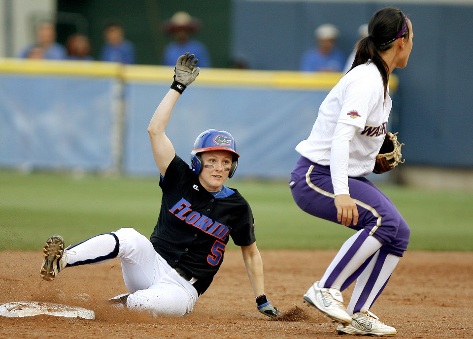 Photo - COLLEGE SOFTBALL / JENN SALLING: University of Florida's Kim Waleszonia slides to second past Washington's Jennifer Salling in the second inning of the second softball game of the championship series between Washington and Florida in Women's College World Series at ASA Hall of Fame Stadium in Oklahoma City, Tuesday, June 2, 2009. Photo by Bryan Terry, The Oklahoman ORG XMIT: KOD
