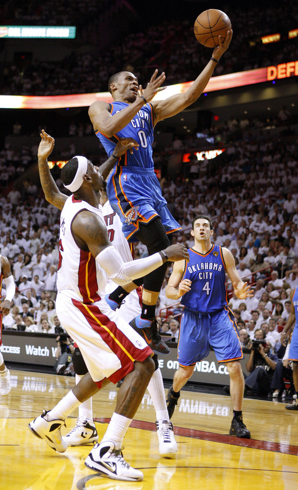 Oklahoma City's Russell Westbrook (0) shoots a lay up as Miami's LeBron James (6) defends during Game 4 of the NBA Finals between the Oklahoma City Thunder and the Miami Heat at American Airlines Arena, Tuesday, June 19, 2012. Photo by Bryan Terry, The Oklahoman