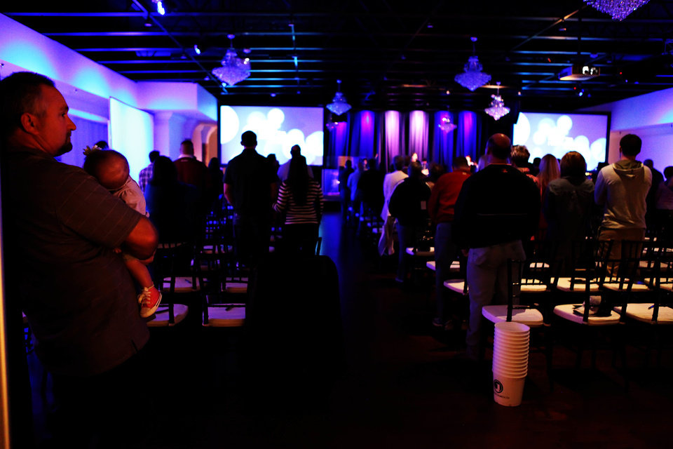 Photo - People participate in worship at the new JourneyChurch.tv Southwest Oklahoma City campus. Photo provided by sharleerotherphotography.com
