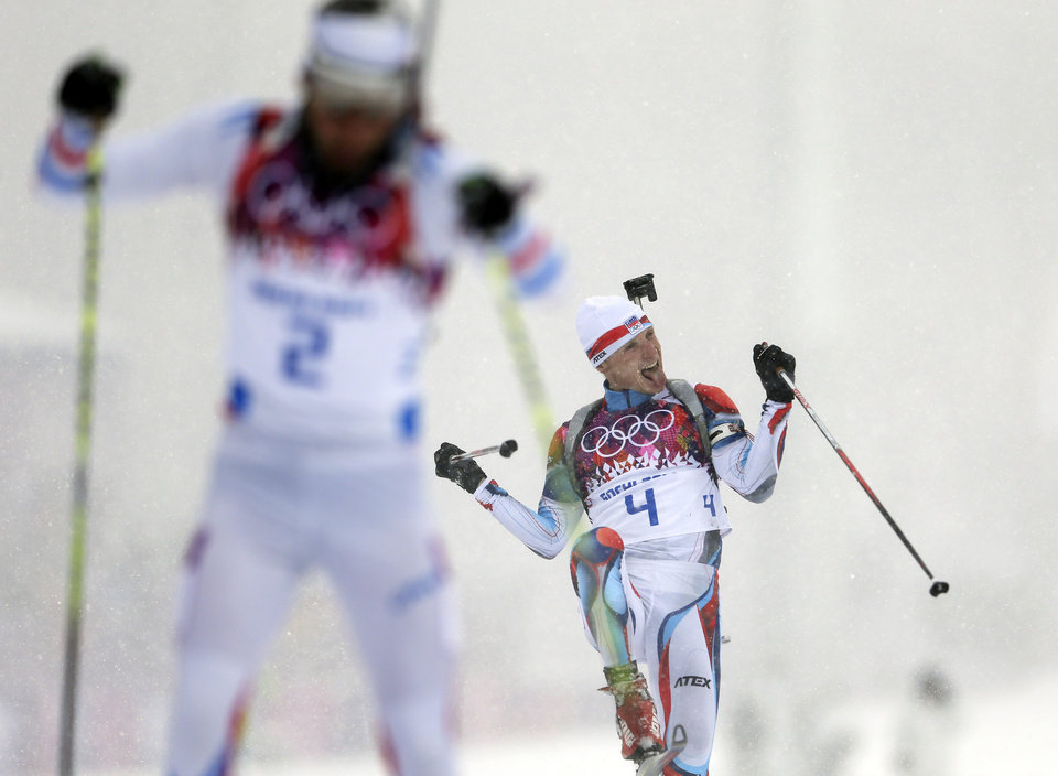 Photo - The Czech Republic's Ondrej Moravec, right, celebrates winning the bronze medal next to silver medalist France's Martin Fourcade, during the men's biathlon 15k mass-start, at the 2014 Winter Olympics, Tuesday, Feb. 18, 2014, in Krasnaya Polyana, Russia. (AP Photo/Felipe Dana, File)