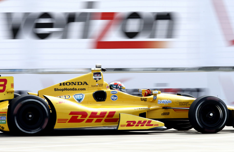 Photo - Ryan Hunter-Reay drives through the course during a practice session for the IndyCar Grand Prix of Houston auto race Friday, June 27, 2014, in Houston. (AP Photo/Juan DeLeon)