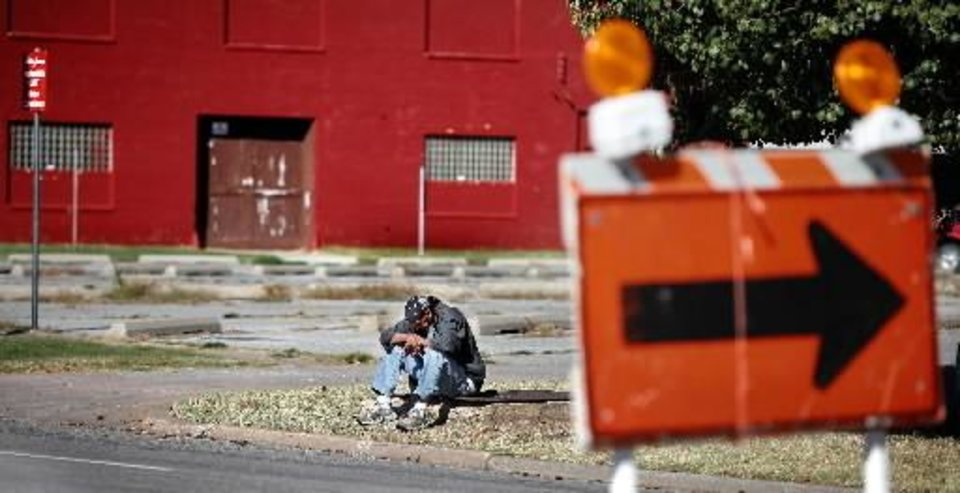 Homeless man named Javier sits on a curb along W Sheridan Avenue near Shartel. Many downtown homeless stay in the area along Sheridan, California and Reno between Walker and Western. Photo taken Wednesday, Oct. 21, 2010. Photo by Jim Beckel, The Oklahoman