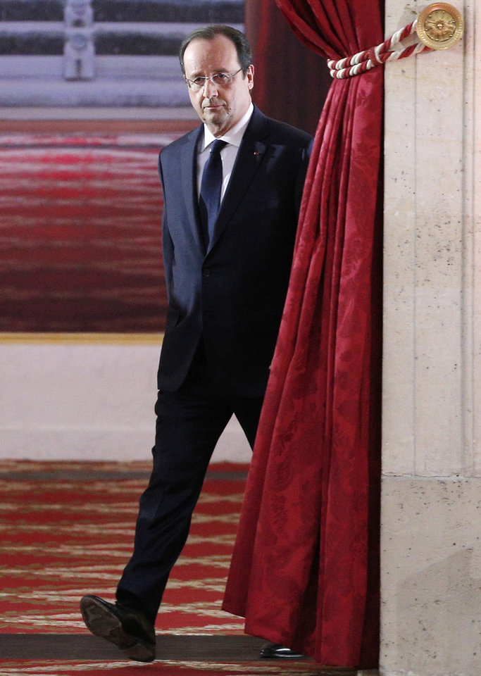 Photo - French President Francois Hollande arrives to deliver his speech at his  annual news conference, Tuesday, Jan.14, 2014 at the Elysee Palace in Paris. The French president's complex personal life — and what it means to be the first lady in modern society — may get a full airing as Hollande answers questions for the first time since a tabloid reported he was having an affair with an actress. (AP Photo/Christophe Ena)