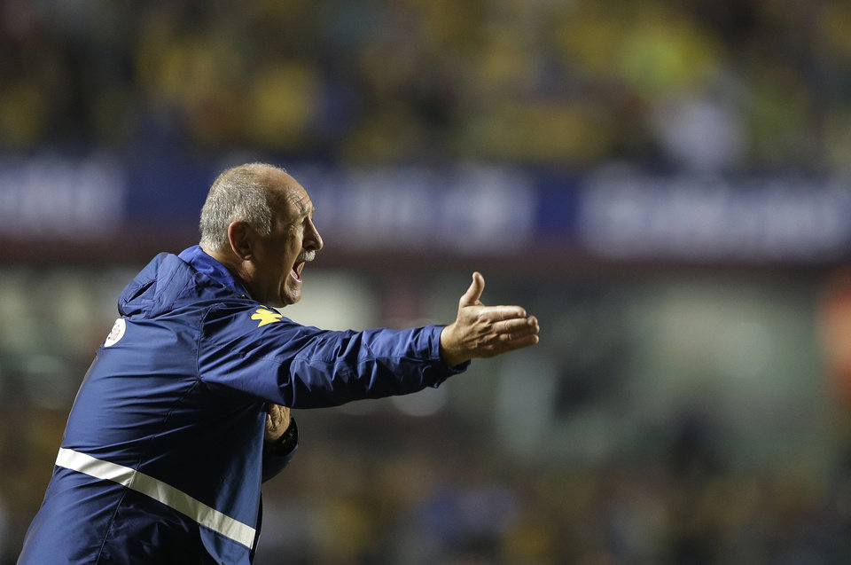 Photo - Brazil's Luiz Felipe Scolari coaches during a friendly soccer match against Serbia at the Morumbi stadium in Sao Paulo, Brazil, Friday, June 6, 2014. Brazil is hosting the World Cup soccer tournament that starts June 12. (AP Photo/Andre Penner)
