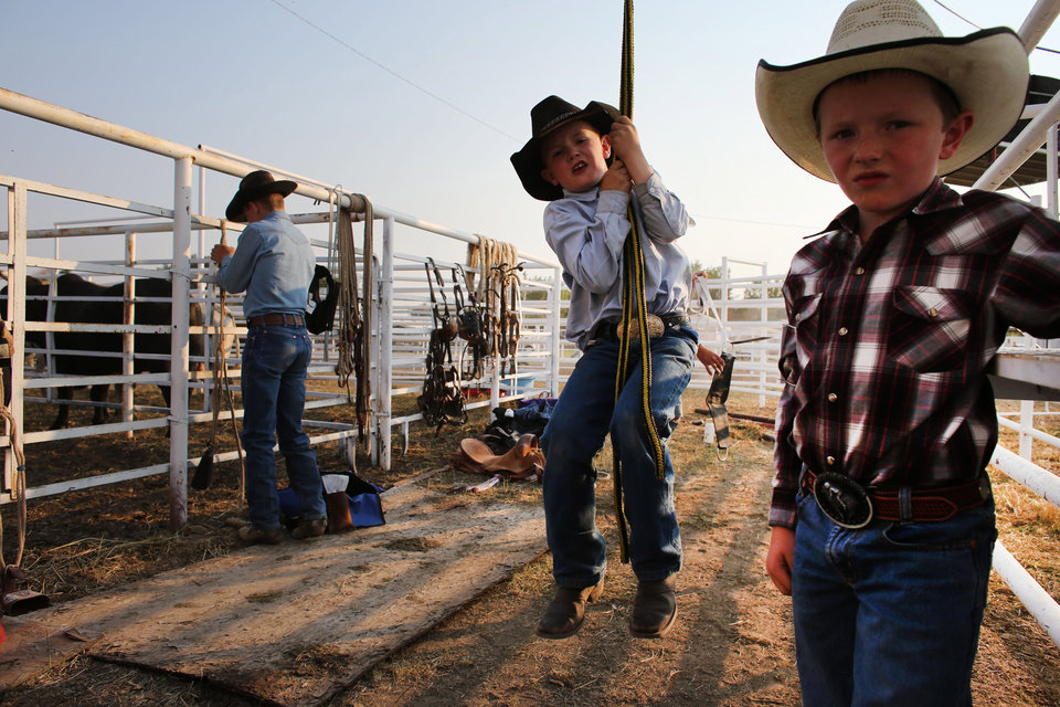 Photo - FILE - In this Aug. 16, 2013 file photo, young cowboys prepare to compete in the annual rodeo in Deer Trail, Colo. This rural town an hour east of Denver that calls itself home of the world's first rodeo has an unusual special election happening on April 1, 2014: Should the city issue hunting licenses to shoot down unmanned aerial drones? (AP Photo/Brennan Linsley, file)