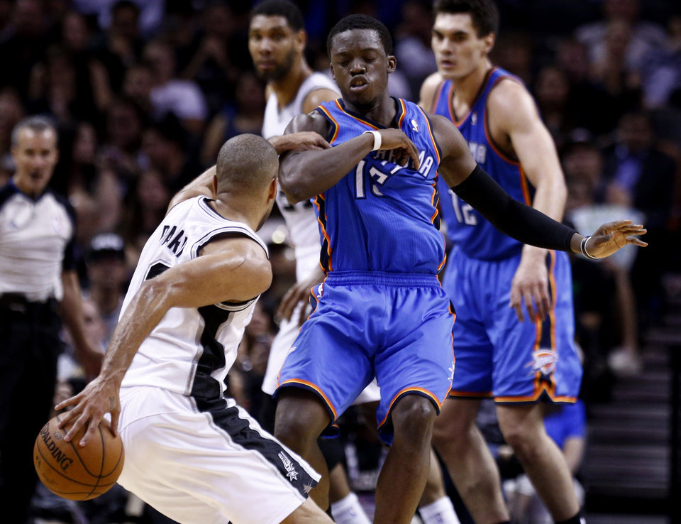 Photo - San Antonio's Tony Parker (9) gets by Oklahoma City's Reggie Jackson (15) during Game 2 of the Western Conference Finals in the NBA playoffs between the Oklahoma City Thunder and the San Antonio Spurs at the AT&T Center in San Antonio, Wednesday, May 21, 2014. Photo by Sarah Phipps