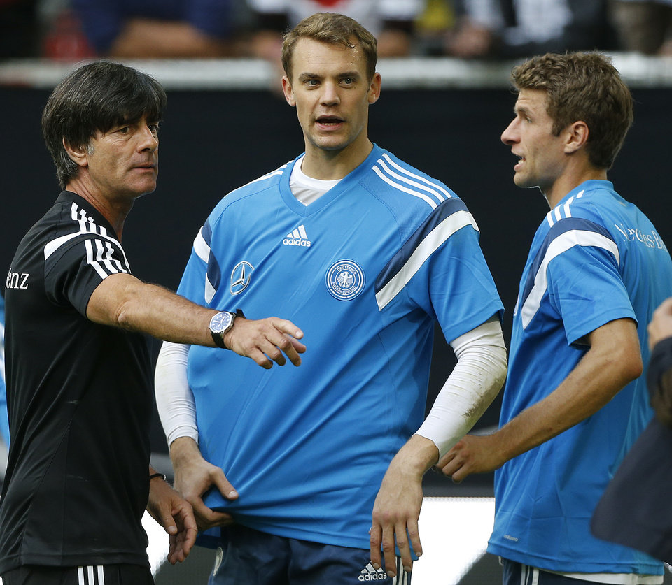 Photo - Gemany's head coach Joachim Loew , left, talks to Manuel Neuer, center,  and Thomas Mueller during an open training session ahead of the friendly soccer match between Germany and Argentina on Wednesday in Duesseldorf, Germany, Monday, Sept. 1, 2014. (AP Photo/Frank Augstein)