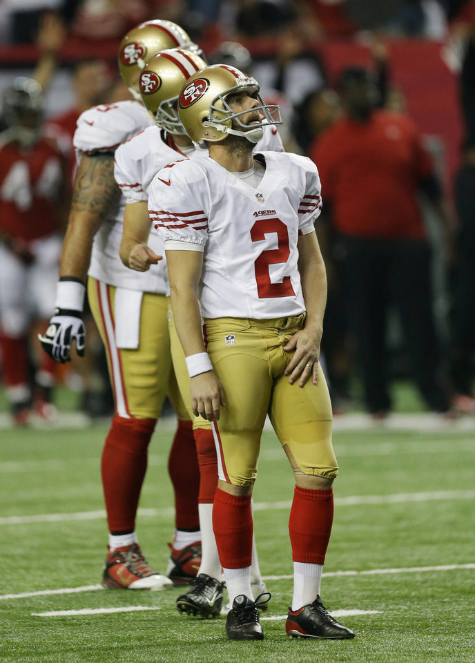 Photo - San Francisco 49ers' David Akers watches his missed field goal during the second half of the NFL football NFC Championship game against the Atlanta Falcons Sunday, Jan. 20, 2013, in Atlanta. (AP Photo/Dave Martin)