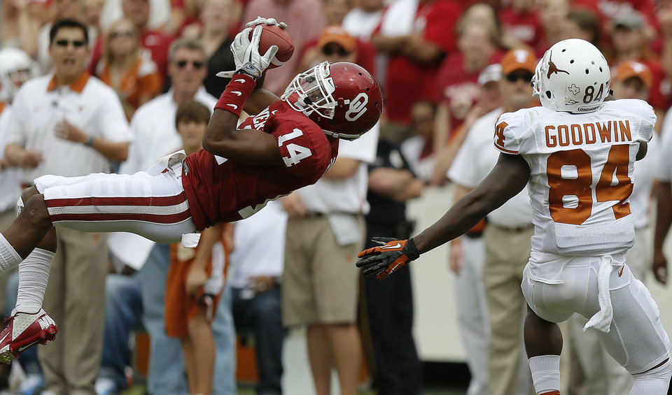 OU's Aaron Colvin (14) intercepts a pass intended for UT's Marquise Goodwin (84) during the Red River Rivalry college football game between the University of Oklahoma (OU) and the University of Texas (UT) at the Cotton Bowl in Dallas, Saturday, Oct. 13, 2012. Photo by Bryan Terry, The Oklahoman