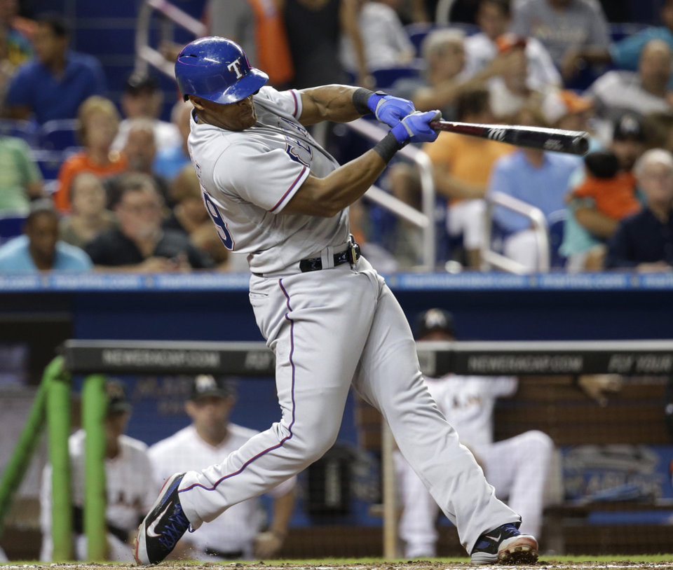 Photo - Texas Rangers' Adrian Beltre swings on a double in the fourth inning during a baseball game against the Miami Marlins, Tuesday, Aug. 19, 2014, in Miami. (AP Photo/Lynne Sladky)