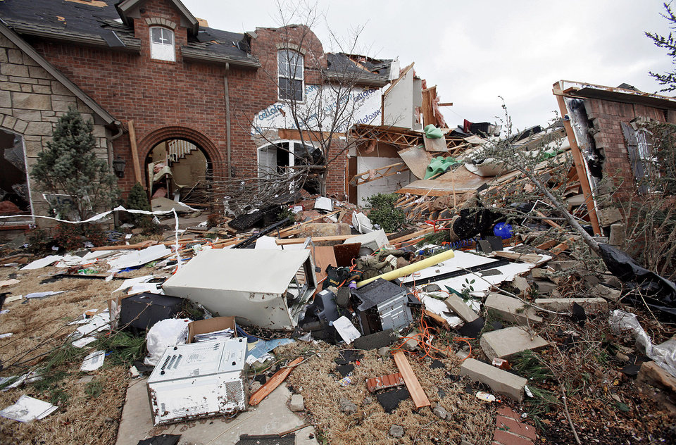 Photo - Homes in the Oak Tree addition of Edmond received major damage. PHOTO BY CHRIS LANDSBERGER, THE OKLAHOMAN