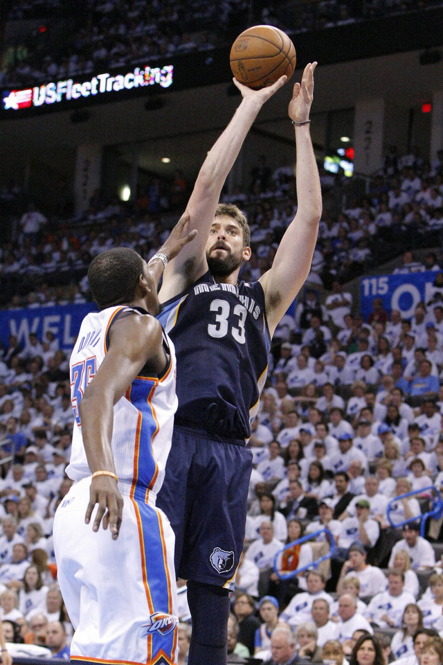 Photo - Memphis Grizzlies Marc Gasol shoots as Oklahoma City Thunder's Kevin Durant defends during the second half of Game 5 of their Western Conference Semifinals NBA basketball playoff series in Oklahoma City, Wednesday, May 15, 2013. Memphis won 88-84. (AP Photo/Alonzo Adams)