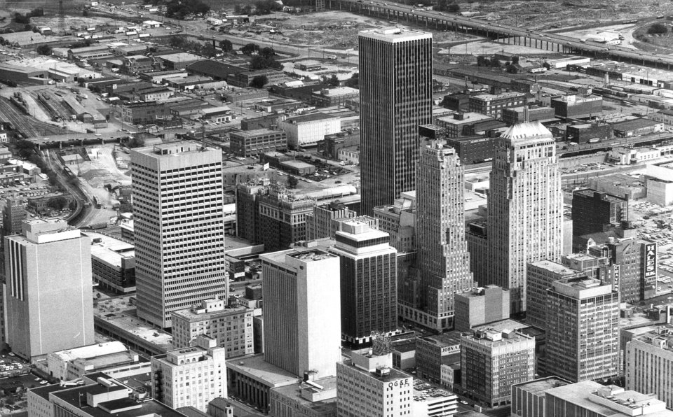 "OKLAHOMA CITY / SKYLINE / AERIAL VIEW:  05-25-1972 by staff photographer Al McLaughlin.    ""CHANGING FACE of Oklahoma City can be seen by comparing these two aerial photographs of the downtown area---the one at right taken in 1948 (and not shown here), and the one above only last week after nearly 10 years of urban renewal work.  At left in the photo above is the still-uncompleted Kerr-McGee Center, with the COTPA parking garage at NW 3 and Broadway peeking out from behind it.  In the center foreground is the Fidelity Bank Plaza, and the city's tallest building, Liberty Tower, looms in the background.  A corner of the Myriad Convention Center can be seen above the Hales Building at right.  Other changes, not part of the urban renewal program, can be seen in the photo above.  Staff photo by Al McLaughlin.""   Photo ran in the 5-30-72 Daily Oklahoman."